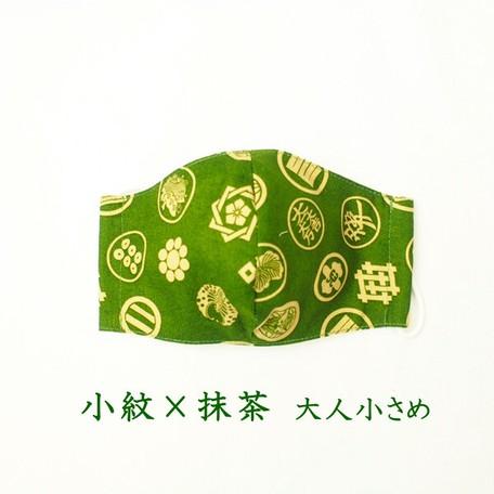 色・緑地に生成りの家紋